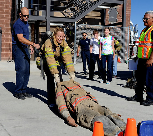 "CU student, Amy Johnson, pulls a 200-pound ""victim"" as her team encourages her.<br /> The Boulder Fire Department hosted the Leadership Fire Academy for University of Colorado students from sororities, fraternities, student government, and other organizations in hopes of giving them life-saving information they care share with their peers.<br /> For more photos and a video, go to  <a href=""http://www.dailycamera.com"">http://www.dailycamera.com</a><br /> Cliff Grassmick / September 25, 2010"