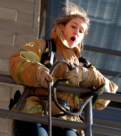 "CU student, Brittany Nelson, pulls a rope to extend a ladder during an exercise.<br /> The Boulder Fire Department hosted the Leadership Fire Academy for University of Colorado students from sororities, fraternities, student government, and other organizations in hopes of giving them life-saving information they care share with their peers.<br /> For more photos and a video, go to  <a href=""http://www.dailycamera.com"">http://www.dailycamera.com</a><br /> Cliff Grassmick / September 25, 2010"