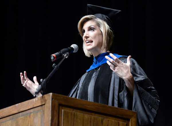 University of Colorado alumni and current 9News anchor Cheryl Preheim tells a story of how her journalism career began to the recent graduates during the Journalism and Mass Communication School graduation on Thursday, Dec. 20, at the Macky Auditorium.<br /> Jeremy Papasso/ Camera