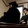 University of Colorado graduate Daniel Edwards stands at the top of the stairs while waiting for the start of the Journalism School graduation on Thursday, Dec. 20, at the Macky Auditorium.<br /> Jeremy Papasso/ Camera