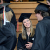 University of Colorado graduate Mackenzie Wolfe, center, laughs with other graduates during the Journalism School graduation on Thursday, Dec. 20, at the Macky Auditorium.<br /> Jeremy Papasso/ Camera