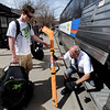"Zachary Clawson, of Los Gatos, CA, is going back home with his hockey sticks. He gets help from Neal Newby of RTD at the Euclid and Broadway bus stop.<br /> University of Colorado students are leaving for Spring break. For more photos of students going back to Cali, go to  <a href=""http://www.dailycamera.com"">http://www.dailycamera.com</a>.<br /> Cliff Grassmick/ March 17, 2011"