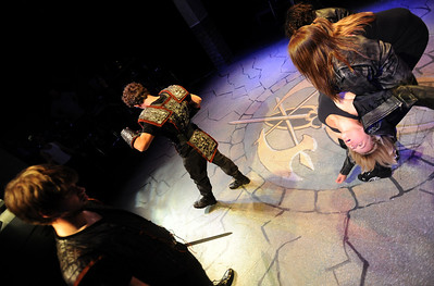 "Actor Brittany Lynn Wolff is being carried away after being defeated in battle by Scott Ryan, top left, in dress rehearsal. Members of the CU Boulder Theatre and Dance Department rehearse the play, ""Tamburlaine: Reign in Blood"" on Sunday night. The theatre department is 50-years old. For more photos of rehearsal, go to www.dailycamera.com. Cliff Grassmick / September 26, 2010"