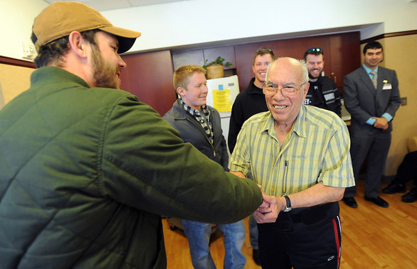 "Veteran, Ernest Jackson, right, greets vet and current CU student, Joe Cafferty, as Lane Masters,  Dan Hartley, John Will and Kenneth Trujillo, look on.<br /> Former military vets who are now attending school at the University of Colorado, visited Fitzsimons Veterans Nursing Home in Denver.<br /> For more photos and a video of the vets, go to  <a href=""http://www.dailycamera.com"">http://www.dailycamera.com</a>.<br /> Cliff Grassmick / March 4, 2012"