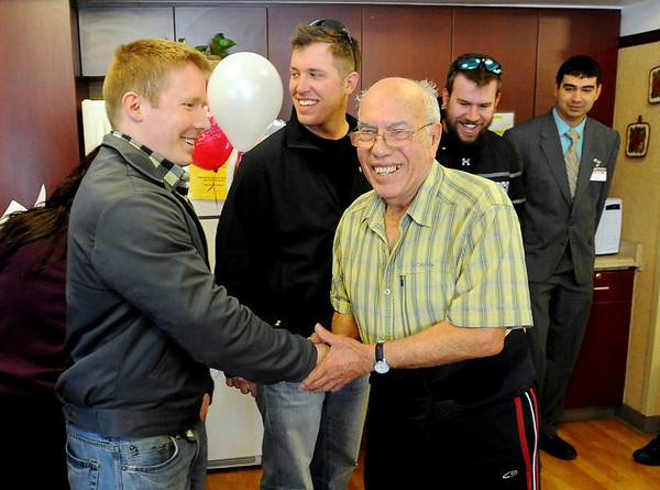 """Veteran, Ernest Jackson, right, greets vet and current CU student, Lane Masters, left, and Dan Hartley, John Will and Kenneth Trujillo, look on.<br /> Former military vets who are now attending school at the University of Colorado, visited Fitzsimons Veterans Nursing Home in Denver.<br /> For more photos and a video of the vets, go to  <a href=""""http://www.dailycamera.com"""">http://www.dailycamera.com</a>.<br /> Cliff Grassmick / March 4, 2012"""