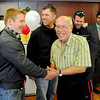 "Veteran, Ernest Jackson, right, greets vet and current CU student, Lane Masters, left, and Dan Hartley, John Will and Kenneth Trujillo, look on.<br /> Former military vets who are now attending school at the University of Colorado, visited Fitzsimons Veterans Nursing Home in Denver.<br /> For more photos and a video of the vets, go to  <a href=""http://www.dailycamera.com"">http://www.dailycamera.com</a>.<br /> Cliff Grassmick / March 4, 2012"