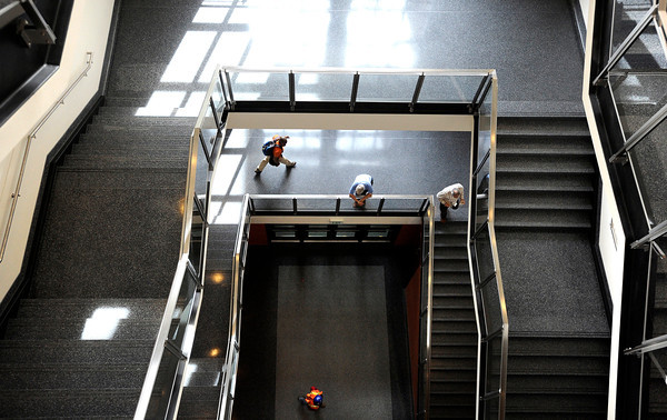 """People walk down the stairs on Wednesday, April 25, at the new Jennie Smoly Caruthers Biotechnology building on the University of Colorado campus in Boulder. For more photos and video of the building go to  <a href=""""http://www.dailycamera.com"""">http://www.dailycamera.com</a> <br /> Jeremy Papasso/ Camera"""