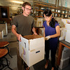 "University of Colorado graduate student Doug Chapnick and doctoral candidate Yingua Peng work together to unpack on Wednesday, April 25, at the new Jennie Smoly Caruthers Biotechnology building on the University of Colorado campus in Boulder. For more photos and video of the building go to  <a href=""http://www.dailycamera.com"">http://www.dailycamera.com</a> <br /> Jeremy Papasso/ Camera"