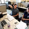 "University of Colorado graduate student Tim Read, left, and assistant professor Robin Dowell talk with each other on Wednesday, April 25, at the new Jennie Smoly Caruthers Biotechnology building on the University of Colorado campus in Boulder. For more photos and video of the building go to  <a href=""http://www.dailycamera.com"">http://www.dailycamera.com</a> <br /> Jeremy Papasso/ Camera"