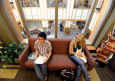 "Lin Zhang, left, and Mary Esch, wait in one of the upper offices of the C4C building at the University of Colorado. The Center for Community building has been designated by the U.S. Green Building Council as a ""platinum"" building -- which means it got the top green rating. For more photos and a video from the C4C, go to www.dailycamera.com Cliff Grassmick / April 27, 2012"