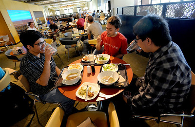 "Saumil Joshi, left, Brad Pelz, Zixu Zhu, have lunch at the C4C on Friday. CU's Center for Community building has been designated by the U.S. Green Building Council as a ""platinum"" building -- which means it got the top green rating. For more photos and a video from the C4C, go to www.dailycamera.com Cliff Grassmick / April 27, 2012"