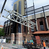 "Workers from D & E Steel of Northglenn, CO, lift up one of the support beams for the new video boards at Folsom Field. The new video panels at each end of the stadium should be installed by the first part of July.<br /> For a video and more photos of the steel work, go to  <a href=""http://www.dailycamera.com"">http://www.dailycamera.com</a><br /> Cliff Grassmick / June 7, 2012"