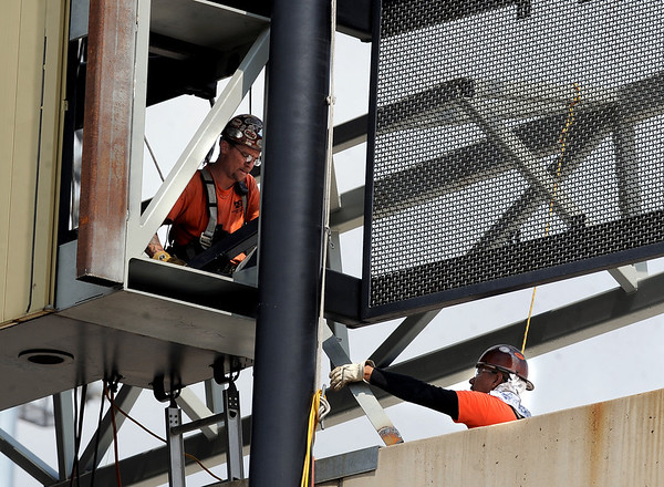 "Workers from D & E Steel of Northglenn, CO, prepare to weld in place one of the support beams for the new video boards at Folsom Field. The new video panels at each end of the stadium should be installed by the first part of July.<br /> For a video and more photos of the steel work, go to  <a href=""http://www.dailycamera.com"">http://www.dailycamera.com</a><br /> Cliff Grassmick / June 7, 2012"