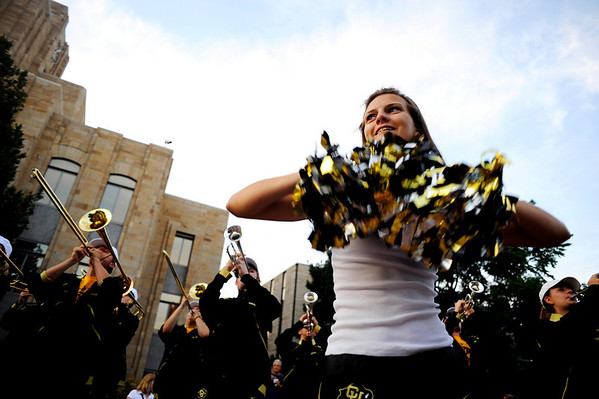 """CU color guard freshman Laken Strotton dances during this year's first Pearl Street Stampede along the Pear Street Mall in Boulder on Friday. The Colorado Buffaloes play the Colorado State Rams tomorrow at Folsom Field for the  annual Rocky Mountain Showdown.<br /> DAILY CAMERA/Kasia Broussalian<br /> For more photos and a video of the event, please visit  <a href=""""http://www.dailycamera.com"""">http://www.dailycamera.com</a>"""