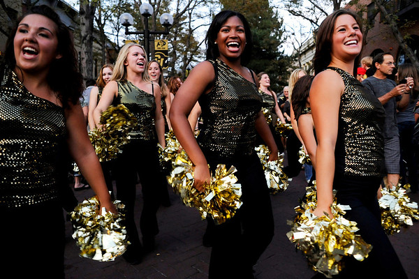 """(From left to right) CU senior Shahlaye Geer, senior Jalesa Moore, and junior Lauren Guillory march as part of the dance team during this year's first Pearl Street Stampede along the Pear Street Mall in Boulder on Friday. The Colorado Buffaloes play the Colorado State Rams tomorrow at Folsom Field for the  annual Rocky Mountain Showdown.<br /> DAILY CAMERA/Kasia Broussalian<br /> For more photos and a video of the event, please visit  <a href=""""http://www.dailycamera.com"""">http://www.dailycamera.com</a>"""