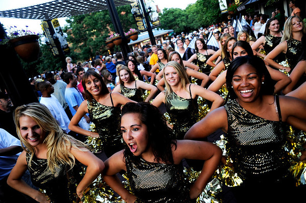 "(From left to right) Lauren Guillory, CU junior, senior Shahlaye Geer, and senior Jalesa Moore lead the dance team and band during this year's first Pearl Street Stampede along the Pear Street Mall in Boulder on Friday. The Colorado Buffaloes play the Colorado State Rams tomorrow at Folsom Field for the  annual Rocky Mountain Showdown.<br /> DAILY CAMERA/Kasia Broussalian<br /> For more photos and a video of the event, please visit  <a href=""http://www.dailycamera.com"">http://www.dailycamera.com</a>"