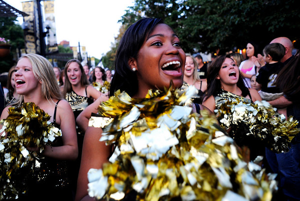 "CU senior Jalesa Moore cheers as part of the dance team during this year's first Pearl Street Stampede along the Pear Street Mall in Boulder on Friday. The Colorado Buffaloes play the Colorado State Rams tomorrow at Folsom Field for the  annual Rocky Mountain Showdown.<br /> DAILY CAMERA/Kasia Broussalian<br /> For more photos and a video of the event, please visit  <a href=""http://www.dailycamera.com"">http://www.dailycamera.com</a>"