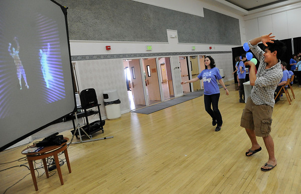 "Maxine Brumer, left, and Josh Coffee, dance wit the Wii screen images during the event.<br /> Wardenburg Health on the University of Colorado campus, hosted ""Rock Your Body"" on Wednesday. The event is about a person's body image.<br /> For  more photos and a video of Rock Your Body, go to  <a href=""http://www.dailycamera.com"">http://www.dailycamera.com</a>.<br /> Cliff Grassmick / March 14, 2012"