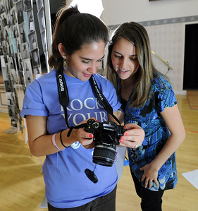 "Gaby Diaz, left,  shows Heather Volkel photos off her holding a message about her body image. Wardenburg Health on the University of Colorado campus, hosted ""Rock Your Body"" on Wednesday. The event is about a person's body image. For  more photos and a video of Rock Your Body, go to www.dailycamera.com. Cliff Grassmick / March 14, 2012"