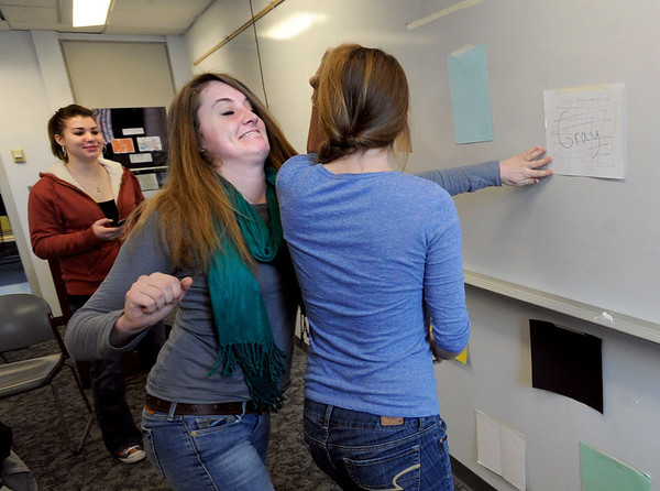 "Anna Van Kueren,  tries to hit the colors called out, but collides with  Kelsey Bennett, right, while demonstrating their game prototype during engineering lab.<br /> The University of Colorado will use a $4.3 million grant to find out why college students are leaving STEM majors. <br />  For  a video and more photos of the engineering labs, go to  <a href=""http://www.dailycamera.com"">http://www.dailycamera.com</a>. <br />  Cliff Grassmick  / February 28, 2013"