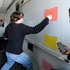 "Levi Cortwright, hits the colors called out by Kelsey Bennett, right, while trying out their game prototype during engineering lab.<br /> The University of Colorado will use a $4.3 million grant to find out why college students are leaving STEM majors. <br />  For  a video and more photos of the engineering labs, go to  <a href=""http://www.dailycamera.com"">http://www.dailycamera.com</a>. <br />  Cliff Grassmick  / February 28, 2013"