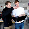"Teaching assistant, Jeff Pitts, left, answers a question from Nick Crowley, during a freshman engineering lab at CU.<br /> The University of Colorado will use a $4.3 million grant to find out why college students are leaving STEM majors. <br />  For  a video and more photos of the engineering labs, go to  <a href=""http://www.dailycamera.com"">http://www.dailycamera.com</a>. <br />  Cliff Grassmick  / February 28, 2013"