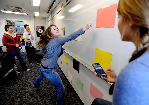 "Anna Van Kueren, hits the colors called out by Kelsey Bennett, right, while demonstrating their game prototype during engineering lab.<br /> The University of Colorado will use a $4.3 million grant to find out why college students are leaving STEM majors. <br />  For  a video and more photos of the engineering labs, go to  <a href=""http://www.dailycamera.com"">http://www.dailycamera.com</a>. <br />  Cliff Grassmick  / February 28, 2013"