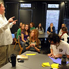 Scot Douglass, left, begins one of his honors classes with Andrews Hall students.<br /> Scot Douglass is an  CU honors professor that teaches and lives at Andrews Hall on the CU campus.<br /> Cliff Grassmick / November 19, 2009