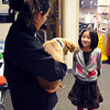 """Daniela Casteneda, an RA at Andrews Hall, shows Breck, the puppy,  to Hannah Douglass, who is also a resident there.<br /> The Douglass family lives with CU students in Andrews Hall.<br /> For more photos, go to  <a href=""""http://www.dailycamera.com"""">http://www.dailycamera.com</a>.<br /> Cliff Grassmick / November 20, 2009"""
