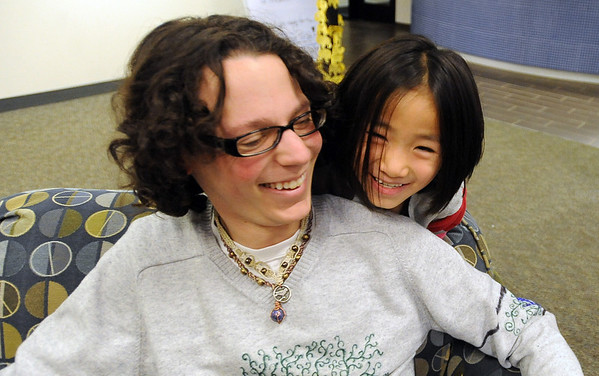 "CU student Jay Hendren gets a surprise visit from Hannah Douglass, 6, in the Andrew Hall commons area.<br /> The Douglass family lives with CU students in Andrews Hall.<br /> For more photos, go to  <a href=""http://www.dailycamera.com"">http://www.dailycamera.com</a>.<br /> Cliff Grassmick / November 20, 2009"
