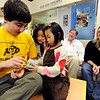"""CU student Eitan Cher, left, helps  Hannah , left, and Thalia Douglass with a cube he designed, while  parents Scot and Kathleen watch in the background.<br /> The Douglass family lives with CU students in Andrews Hall.<br /> For more photos, go to  <a href=""""http://www.dailycamera.com"""">http://www.dailycamera.com</a>.<br /> Cliff Grassmick / November 20, 2009"""