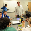 Scot Douglass, center, begins one of his honors classes with Andrews Hall students.<br /> Scot Douglass is an  CU honors professor that teaches and lives at Andrews Hall on the CU campus.<br /> Cliff Grassmick / November 19, 2009