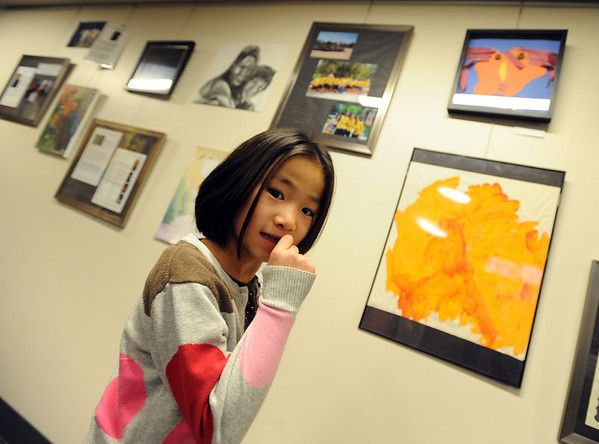 "Hannah Douglass has an art creation, top right, on the wall of the commons area of Andrews Hall.<br /> The Douglass family lives with CU students in Andrews Hall.<br /> For more photos, go to  <a href=""http://www.dailycamera.com"">http://www.dailycamera.com</a>.<br /> Cliff Grassmick / November 20, 2009"