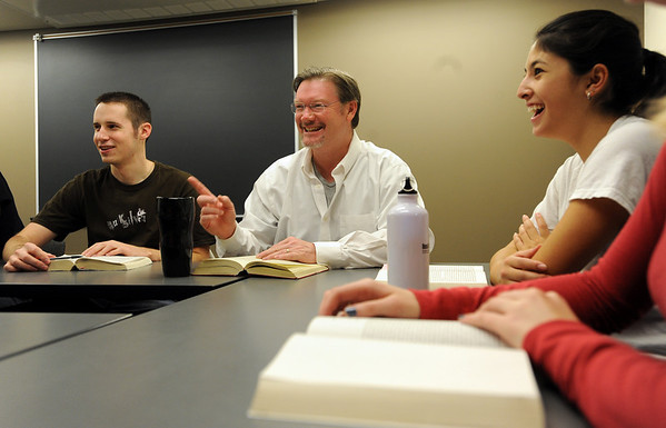Professor Scot Douglass, center, talks about the next course of action for his class, including Drew Parker, left, and Michele Davis, right.<br /> Scot Douglass is an  CU honors professor that teaches and lives at Andrews Hall on the CU campus.<br /> Cliff Grassmick / November 19, 2009