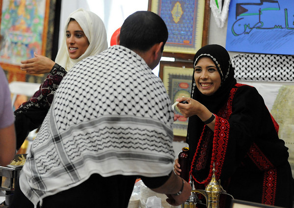 "Srrah Algheithy, left, and Vera Salayma, serve traditional food from the Palestine booth at the festival.<br /> The University of Colorado hosted the 20th Annual International Festival on Saturday that featured traditions, customs and food  from around the world.<br /> For more photos and a video, go to  <a href=""http://www.dailycamera.com"">http://www.dailycamera.com</a>.<br /> Cliff Grassmick / April 24, 2010"
