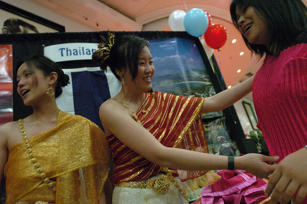 "Nichanad Rattanasuwongchai, left, Varita Hongsunirundon, and Pornsawan Poopat, put on traditional Thai dresses for their performance at the festival.<br /> The University of Colorado hosted the 20th Annual International Festival on Saturday that featured traditions, customs and food  from around the world.<br /> For more photos and a video, go to  <a href=""http://www.dailycamera.com"">http://www.dailycamera.com</a>.<br /> Cliff Grassmick / April 24, 2010"