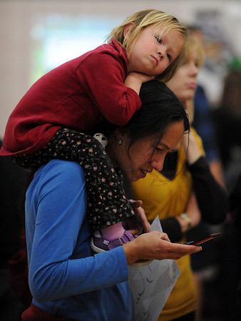 "Sarah Rupert finds a comfortable spot on her mother Kemi, during the festival.<br /> The University of Colorado hosted the 20th Annual International Festival on Saturday that featured traditions, customs and food  from around the world.<br /> For more photos and a video, go to  <a href=""http://www.dailycamera.com"">http://www.dailycamera.com</a>.<br /> Cliff Grassmick / April 24, 2010"