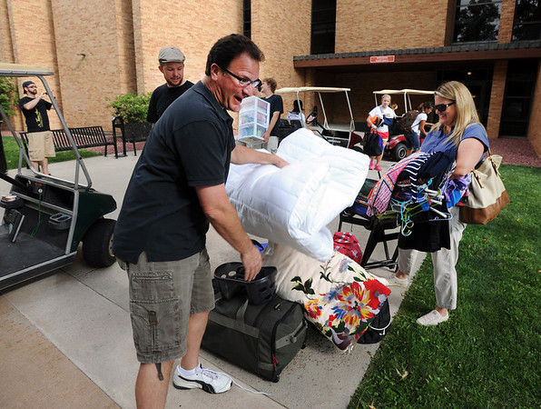 "Scott Doughty, left, and wife, Lisa, gather the belongings of their daughter, Allison, for the move into Stearns East at CU's Williams Village on Thursday.<br /> For more photos and a video of the Williams Village move in, go to  <a href=""http://www.dailycamera.com"">http://www.dailycamera.com</a>.<br /> Cliff Grassmick  / August 23, 2012"