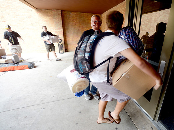 "Sam Router and his dad, Richard, move in Sam's dorm stuff into Stearns East at CU's Williams Village on Thursday.<br /> For more photos and a video of the Williams Village move in, go to  <a href=""http://www.dailycamera.com"">http://www.dailycamera.com</a>.<br /> Cliff Grassmick  / August 23, 2012"