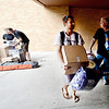 "Sam Router, left, and his dad, Richard, move in Sam's dorm stuff into Stearns East at CU's Williams Village on Thursday.<br /> For more photos and a video of the Williams Village move in, go to  <a href=""http://www.dailycamera.com"">http://www.dailycamera.com</a>.<br /> Cliff Grassmick  / August 23, 2012"