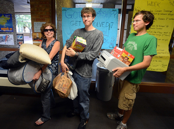 """Nancy Roncevich, left, and her sons, Evan and Taylor, wait for the elevator in Stearns East during the Williams Village move in on Thursday.<br /> For more photos and a video of the Williams Village move in, go to  <a href=""""http://www.dailycamera.com"""">http://www.dailycamera.com</a>.<br /> Cliff Grassmick  / August 23, 2012"""
