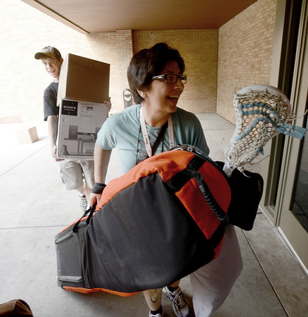 """Kathline Router takes her son, Sam's, belongings into Stearns East at CU's Williams Village on Thursday.<br /> For more photos and a video of the Williams Village move in, go to  <a href=""""http://www.dailycamera.com"""">http://www.dailycamera.com</a>.<br /> Cliff Grassmick  / August 23, 2012"""