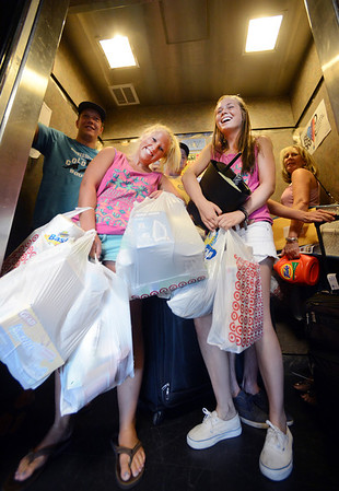 "Amanda Weiland, left, and Hanna Doyle, both of the Kappa Kappa Gamma Sorority, help parents and new students move into Williams Village on Thursday. Many campus groups volunteered for the move in.<br /> For more photos and a video of the Williams Village move in, go to  <a href=""http://www.dailycamera.com"">http://www.dailycamera.com</a>.<br /> Cliff Grassmick  / August 23, 2012"