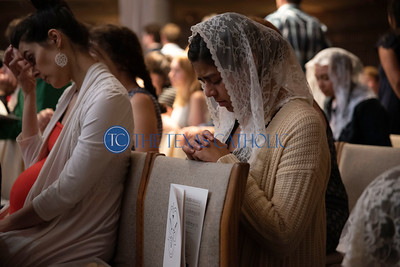 University of Dallas student Leah Tepichin reflects after receiving communion during te Mass of the Holy Spirit at the Church of the Incarnation August 27. (Jenna Teter/Special Contributor)