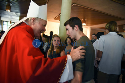 Bishop Edward J. Burns greets University of Dallas freshman Dominic Martin after celebrating the Mass of the Holy Spirit At the Church of the Incarnation August 27. (Jenna Teter/Special Contributor)