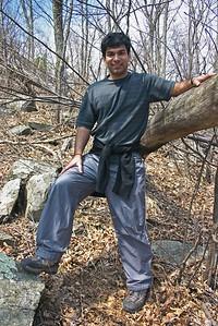 Ankur hand on log