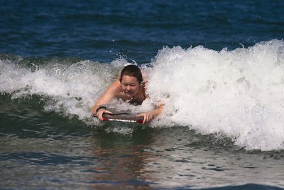 Kristin surfing wave 2