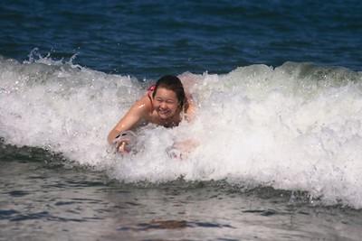 Kristin surfing wave 3