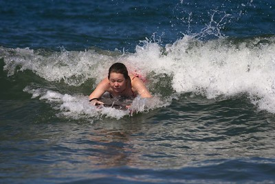 Kristin surfing wave