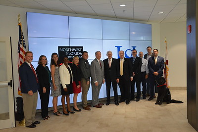 Dignitaries at the signing for Pathway USA which allows for seamless transfers of Northwest Florida State College graduates to University of South Alabama. Pictured from left to right are; Christopher Lynch, USA Associate VP for Enrollment Services, Christie Kedroski, NWF VP of College Advancement, Julie Schrodt, NWF Executive Assistant to the President, Pauline Anderson, NWF Dean of Institutional Research, Laura Coale, NWF Exec. Dir. Strategic Comm., Dr. Nate Slaton, NWF VP Student Success, Dr. Devin Stephenson, NWF President, Dr. Tony Waldrop, USA President, Dr. David Johnson, USA Provost and SVP Academic Affairs, Mike Haskins, USA VP Marketing and Communications, Randy White, NWF VP of Business Operations and Finance, Cole Allen, NWF Chief Information Officer, Jack Capra, NWF General Council/Exec. Officer, Rocco, NWF Exec. Pawfficer.